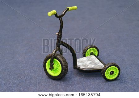 children's scooter three wheeled. isolated on cover