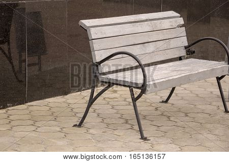 City wood bench standing on the street