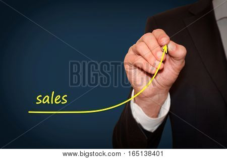 Businessman draw growing line symbolize growing company sales