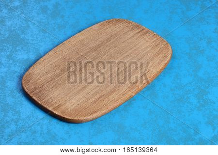 The board is for cutting of foods on blue background