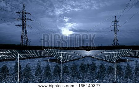 Solar energy panels with electricity pylon at night
