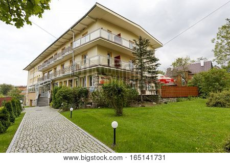 ZAKOPANE POLAND - SEPTEMBER 20 2016: Holiday House that is named Wanta which offers 70 beds is located nearly a center of the city. To the building leads a cobbled path.