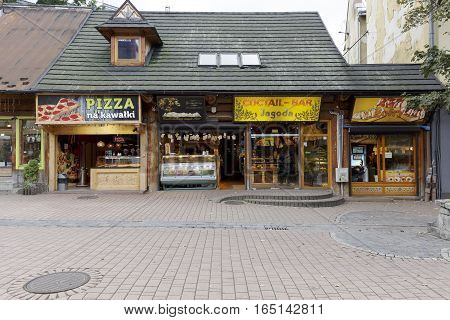 ZAKOPANE POLAND - SEPTEMBER 20 2016: Four various small eateries. Food from snack bars along the Krupowki street is very popular among tourists coming to town in a high season.