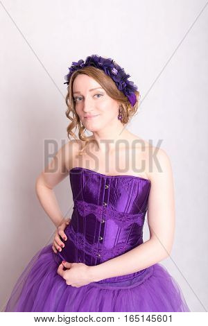 woman in a purple dress and a wreath