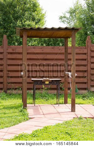 BBQ on site under a wooden canopy