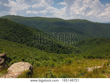 Summertime sunrise in Bieszczady Mountain range with view from Bukowe Berdo and rock in foreground, Bieszczady Ridge, Poland, Europe
