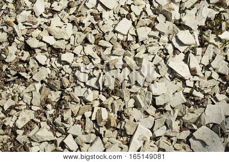 A layer of grey limestone rubble for the background. Stone texture