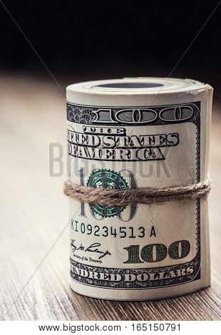 Dollar currency. Dollar banknotes rolled in other positions.