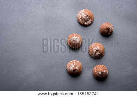 Truffles Sprinkled With Cocoa Powder On A Dark Background