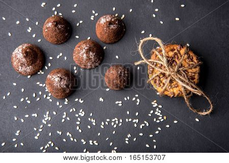Truffles And Cookies Tied Up With Rope On Black Background