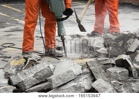 horizontal photography of workers men demolishing asphalt