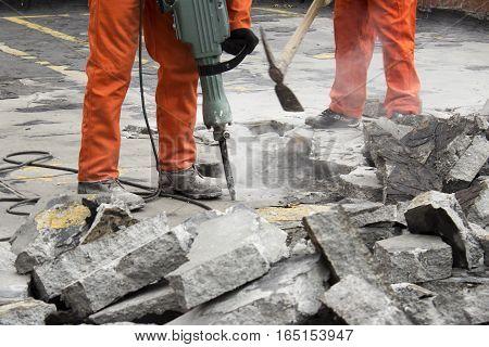 horizontal photography of workers men demolishing asphalt