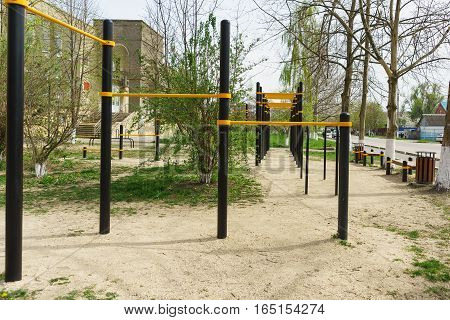 Playground with a horizontal bar on a city street