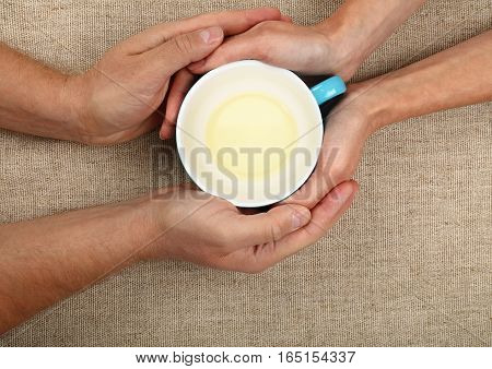 Man And Woman Hands Hold Empty Green Tea Cup