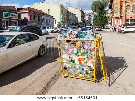 SAMARA RUSSIA - SEPTEMBER 10 2016: The container for collecting plastic bottles of various drinks for recycling on the city street in summer sunny day