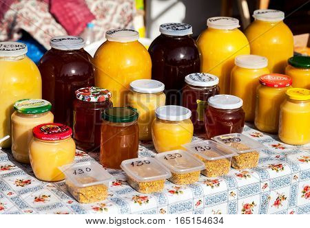 SAMARA RUSSIA - SEPTEMBER 10 2016: Sweet fresh honey ready for sale at the traditional farmers market in Russia