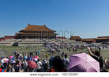 Beijing China - July 29 2012: Visitors entering in the Forbidden City in Beijing China.