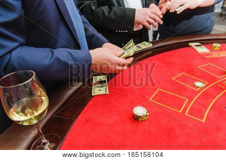 The player, man counts the money in the casino