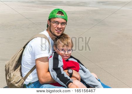 Big Brother With Little Brother With Downs-Syndrome at the Beach