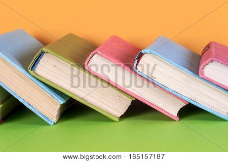 Set of colored books in bright colorful background.free copy space. Back to school copy space. Education background.