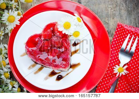Strawberry heart cake dessert on Valentines Day classic Valentines Day heart-shaped cake with fresh strawberries in jelly gluten-free dessert
