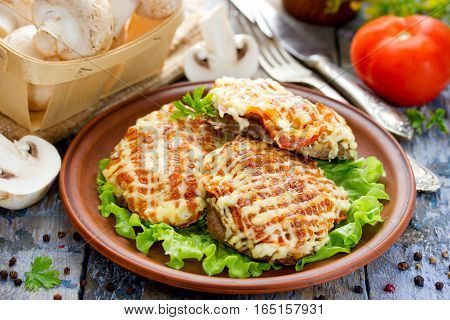 Veal Orloff or Meat in French - baked meat with mushrooms tomatoes onion and cheese