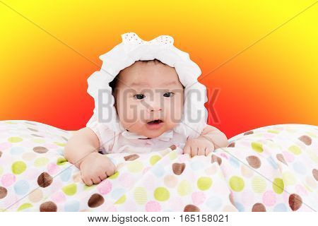 Portrait Of Adorable Baby Girl. Isolated On Warm Background With Copy Space