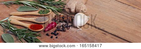 Variety of spices on kitchen table - food
