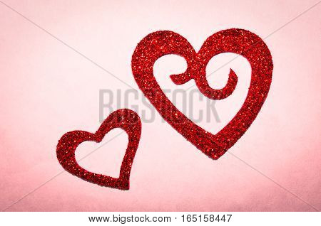 Sparkle, glitter and twinkle of red hearts.  Romantic symbol of Love.  Valentine's Day, Wedding, Anniversary or romance.
