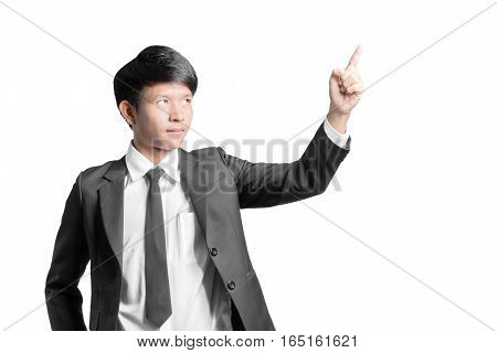Portrait Of A Handsome Businessman Pointed The Finger To Top. Isolated On White Background