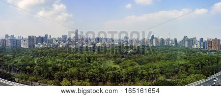 Daan Forest Park And Taipei Cityscape