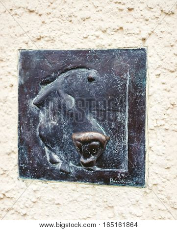 BADEN-BADEN GERMANY - NOV 20 2014: Abstract sculpture of monkey statue on the wall of Baden-Baden Germany