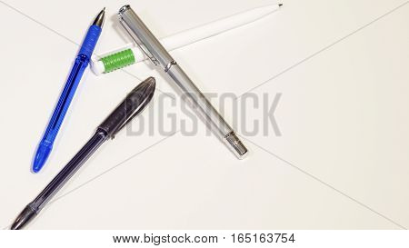 Multi-colored isolated pens on a white background