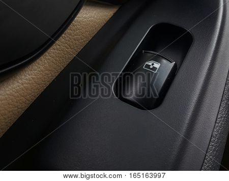 Button to turn off the car window.
