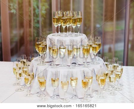 many of the champagne glasses on the table. Soft Focus Selective Focus