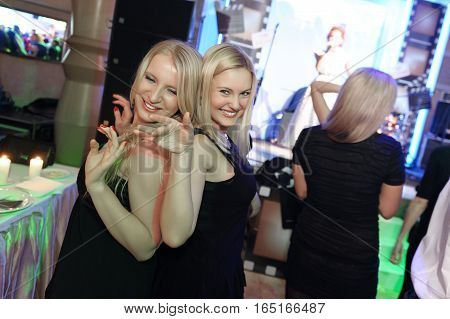 Girls having fun and spend a good time together.Female friends have a good time at the party