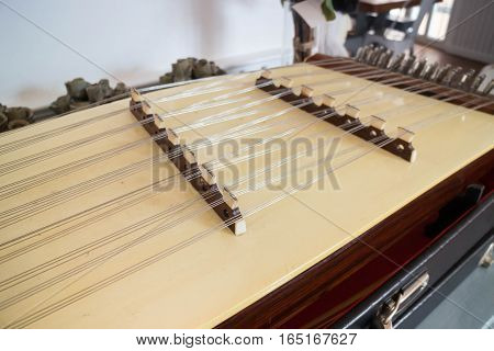 Wooden Thai dulcimer traditional musical instrument stock photo