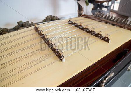 Wooden Thai dulcimer traditional musical instrument stock photo