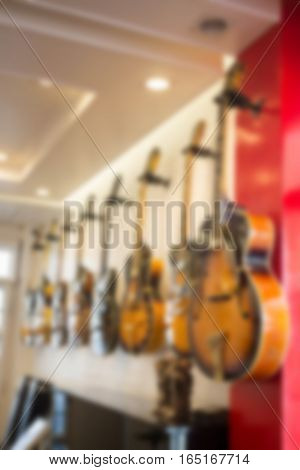 Blurred electric guitar in the shop stock photo