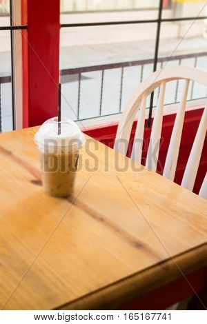 Iced coffee serving on wooden table stock photo