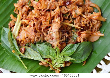 spicy chicken tendon salad on banana leaf