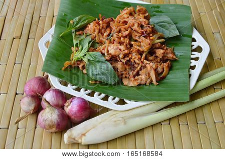 spicy chicken ligament salad on banana leaf