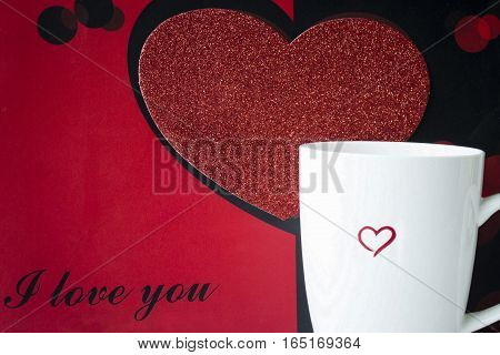horizontal image of a black and red background with a big red heart and text saying