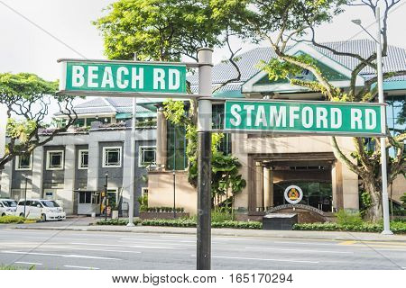 SINGAPORE-OCT 15 2016: The road name Stamfort Rd and Beach Rd on traffic sign in the city