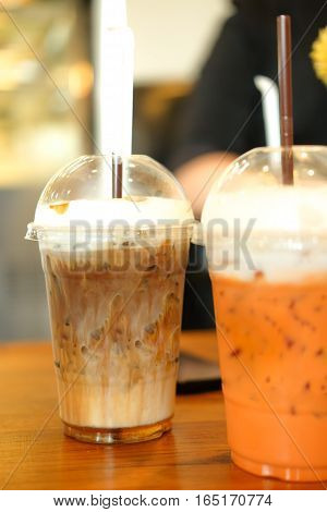 ice coffee in takeaway cup at coffee shop