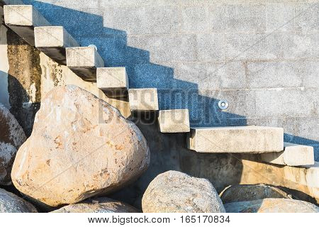 stone and concrete ladder on beach to house