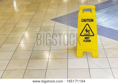 yellow wet sign on the floor - can use to display or montage on product