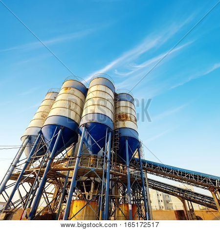 Small outdoor cement plant in blue sky background