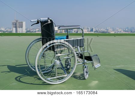 wheelchair the background is a building deck