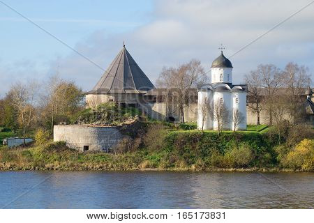 Medieval orthodox church of St. George on the ruins of Old Ladoga fortress, cloud October day. Leningrad region, Russia